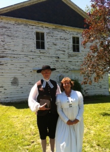 "Rev David Pritchard of Grace United Church in NOTL poses with Beaverdams Church Board member Melanie Battell as 1813 characters ""Rev Ninian Holmes"" and friend"