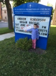 Young Christian Henderson in front of St Andrew's Presbyterian, Thorold